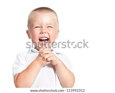 admiring  little boy laughing isolated over white - stock photo