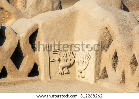 Adobe ruins of the ancient city of Chan Chan in Trujillo, Peru - stock photo
