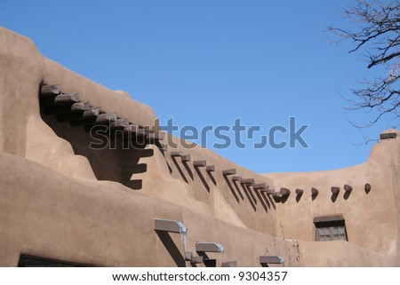 Adobe style building with wood beams - stock photo