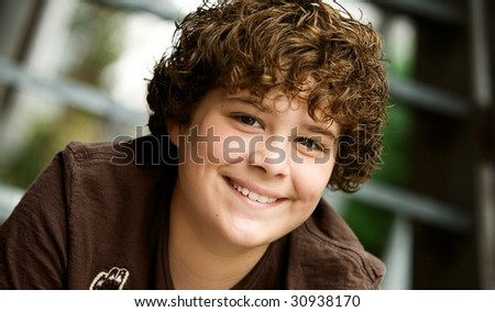 adolescent boy smiling - stock photo