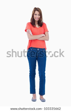 Adolescent crossing her arms while wearing relaxed clothes - stock photo
