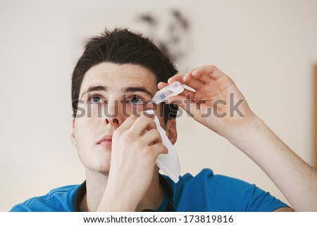 Adolescent Using Eye Lotion