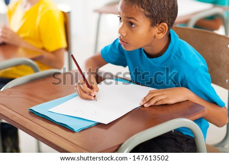 adorable african american primary school student studying Chinese in classroom - stock photo