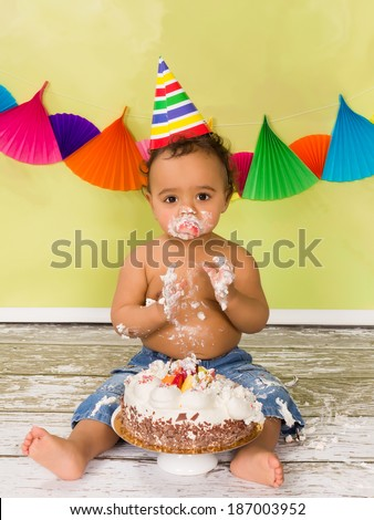 Adorable african baby during a cake smash on his first birthday - stock photo
