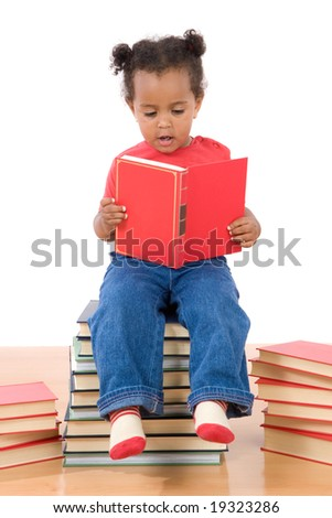 Adorable african baby reading sitting on a pile of books on a over white background - stock photo