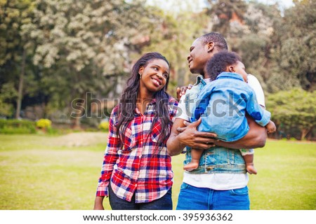 adorable african family walking in the park - stock photo