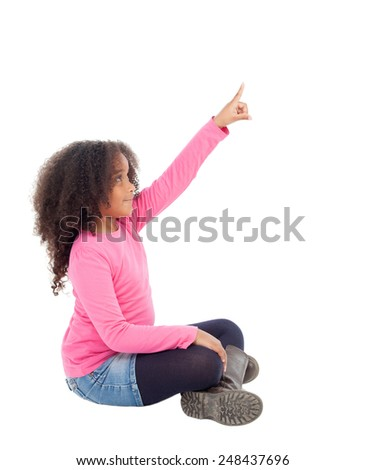 Adorable african little girl indicating something with her finger isolated on white background - stock photo