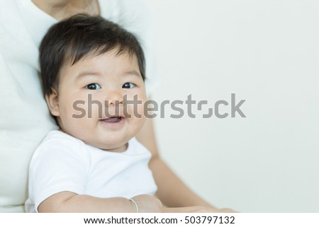Adorable asian baby girl smiling with copy space. (Vintage tone)