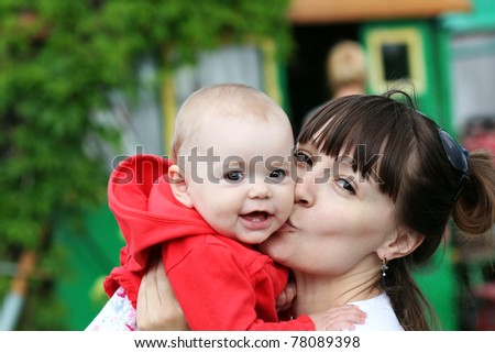 Adorable baby and mother - stock photo