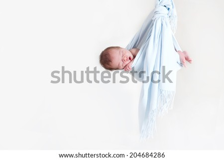 Adorable baby boy in a little bundle, sleeping - stock photo