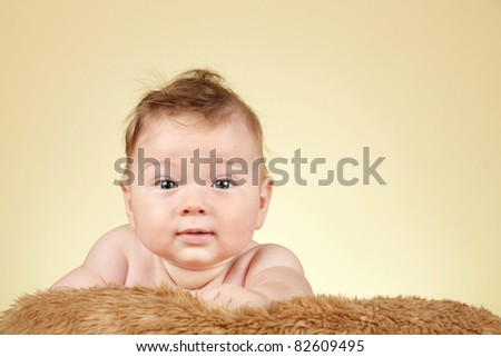Adorable baby boy on fur blanket