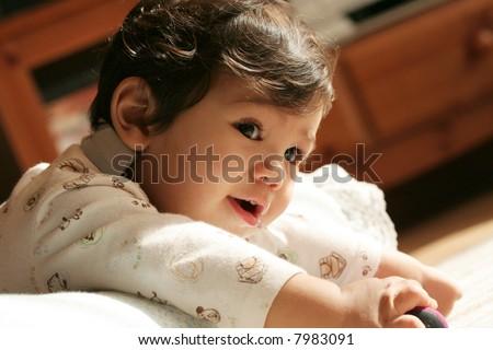 Adorable baby boy playing on floor. Part Scandinavian, asian descent. - stock photo