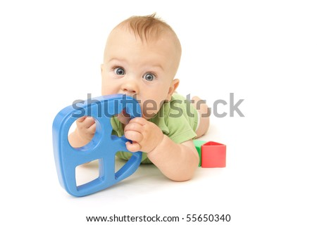 Adorable Baby Boy playing with blocks and shapes, on white background