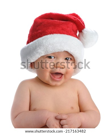 Adorable baby boy wears a Santa hat for his first Christmas, isolated on white. - stock photo