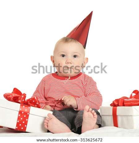 Adorable baby boy with gifts   on a white background - stock photo