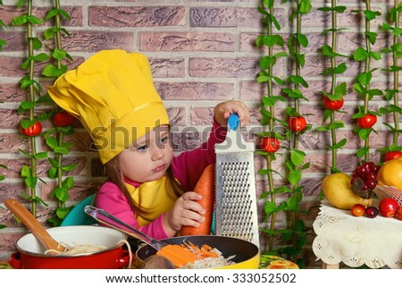 adorable baby cooking in kitchen. little cute child in costume of Cook. little girl in a suit of the cook in the kitchen preparing soup. happy cute little baby in a cook cap laughs - stock photo
