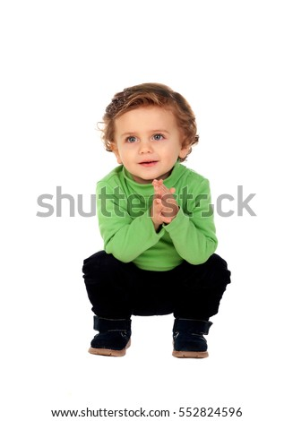 Adorable baby crouching down isolated on a white background