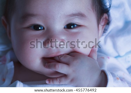 Adorable baby girl close up  .newborn child relaxing and smile close up of face baby .2-6 months two-six months baby healthy concept. - stock photo