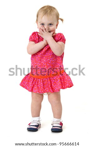 adorable baby girl looking embarrassed and shy - stock photo