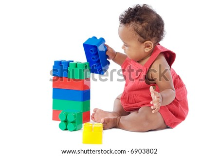 Adorable baby girl playing with building blocks - stock photo