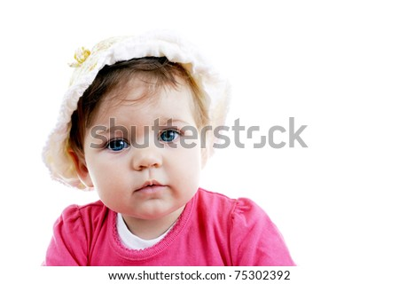 Adorable baby girl posing in studio against white background, copy space