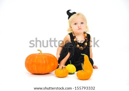 Adorable Baby Girl sitting on a Pumpkin - stock photo