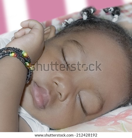 Adorable baby girl sleeping in her room (one year old)  - stock photo