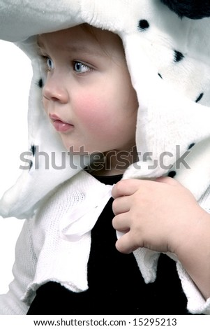 Adorable baby girl with white hat, profile - stock photo