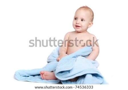 adorable baby girl wrapped in blue blanket
