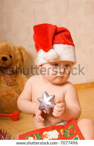 Adorable baby in Christmas hat - stock photo