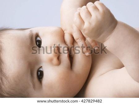 Adorable baby in studio shot - stock photo