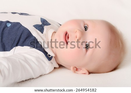 Adorable baby on a white background - stock photo
