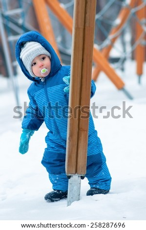 Adorable baby on playground - stock photo