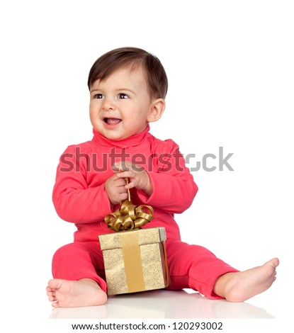 Adorable baby playing with a present isolated on white background - stock photo