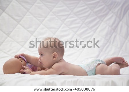 Adorable  baby playing with baby toy.Nursery for young children. Textile and bedding for kids