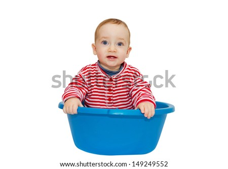 Adorable baby sit in a blue basin, isolated on a white background  - stock photo