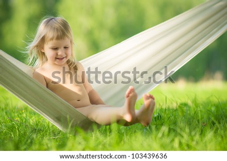 Adorable baby swing sitting in hammock