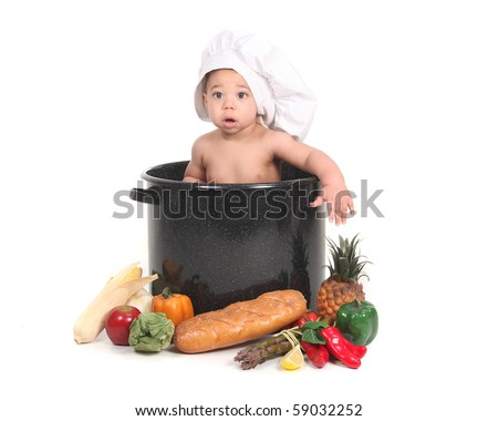Adorable Baby Taking a Portrait in a Chef Themed Studio Set - stock photo