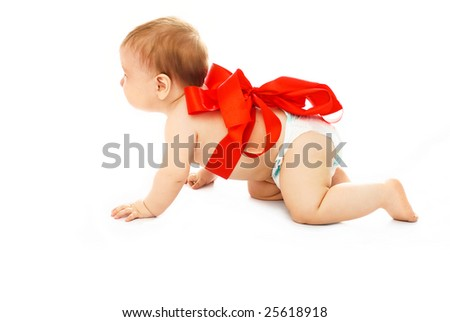 adorable baby tied up with a red ribbon isolated against white background - stock photo