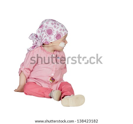 Adorable baby with a headscarf beating the disease isolated on white background - stock photo