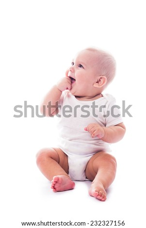 Adorable baby with finger in the mouth - stock photo
