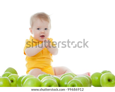 Adorable baby with green apples - stock photo