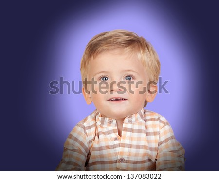 Adorable baby with plaid shirt on blue background - stock photo