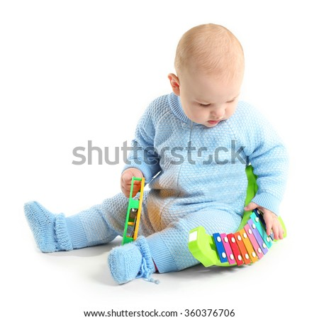 Adorable baby with plastic colourful toys isolated on white background - stock photo