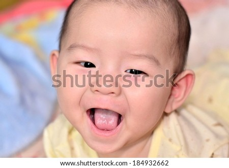 Adorable baby with sweet smile face closeup