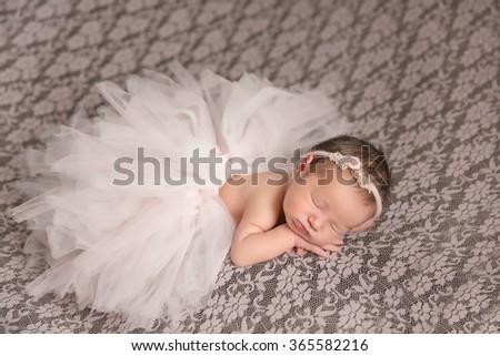 Adorable beautiful newborn baby girl. Maternity and newborn concept. Newborn baby is sleeping - stock photo