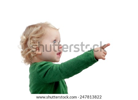 Adorable blond baby indicating something isolated on a white background - stock photo