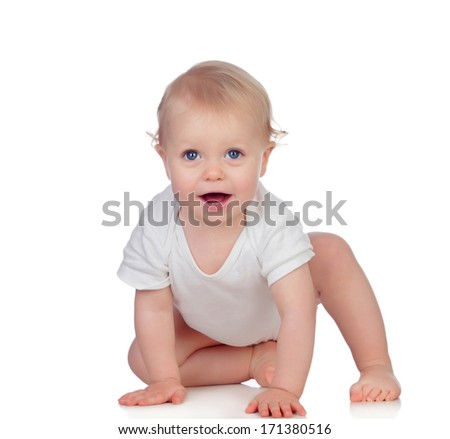 Adorable blonde baby in underwear crawling isolated on a white background