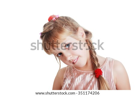 adorable blonde girl with pigtails smiles in studio - stock photo