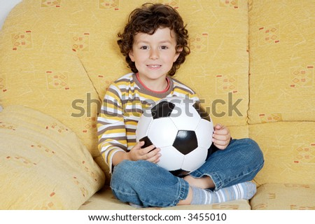 adorable boy dreaming about being soccer player
